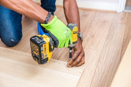 home renovation worker holding drill